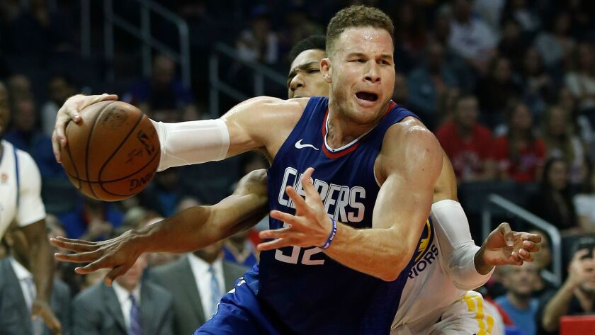 Los Angeles Clippers forward Blake Griffin drives to the basket against Golden State Warriors guard Patrick McCaw during the first half.