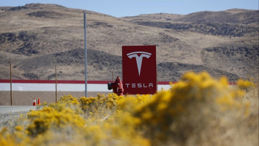 In this Oct. 13, 2018, photo, a sign marks the entrance to the Tesla Gigafactory in Sparks, Nev. A p
