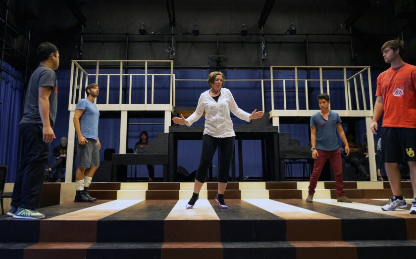 """In rehearsal, Susan Narucki as Mrs. Peachum is surrounded by some of the bad boys in 'The Threepenny Opera,"""" with performances May 6, 8, 9, 10, 2015 at UCSD's Conrad Prebys Music Center Experimental Theater."""