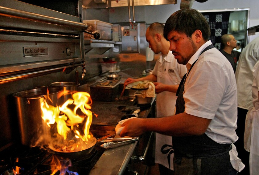 Ricardo Zarate, co-owner and chef of the now-closed Mo–Chica, has signed on to do a pop-up dinner series in Santa Monica. Pictured is Zarate cooking in the kitchen at Mo-Chica.