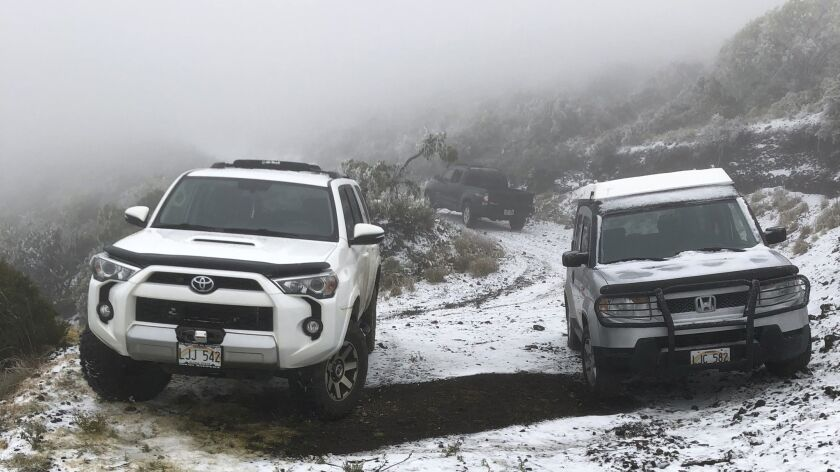 Snow on the ground in Polipoli Spring State Recreation Area in Kula, Hawaii, on the island of Maui. A strong storm that hit Hawaii knocked out power, brought down tree branches, flooded coastal roads and even brought snow.