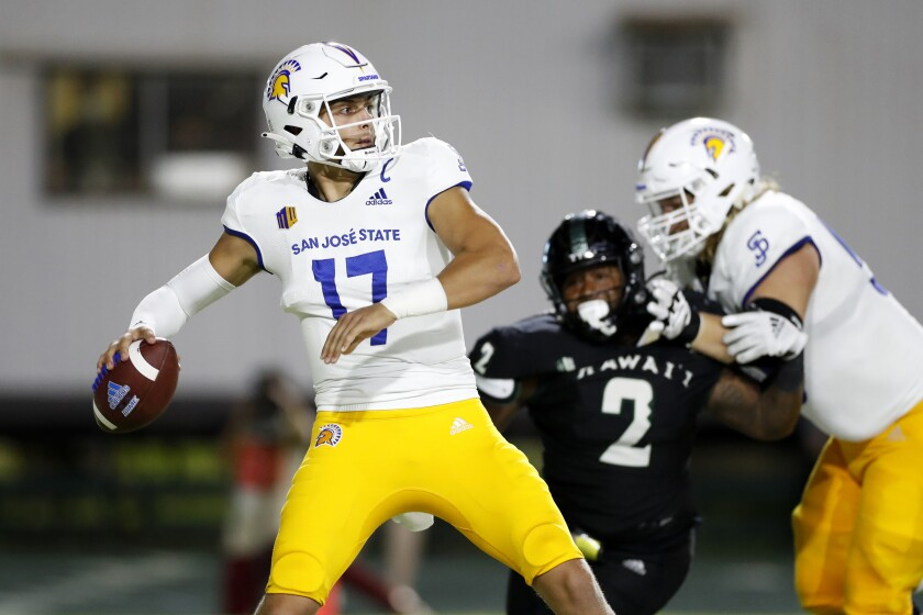 While under pressure from the Hawaii defense, San Jose State quarterback Nick Starkel (17) throws an interception during the second half of an NCAA college football game, Saturday, Sept. 18, 2021, in Honolulu. (AP Photo/Marco Garcia)