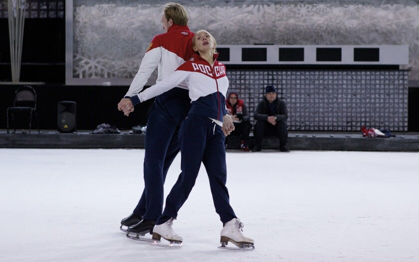 Former Russian figure skater and 2006 Olympic gold medalist Tatiana Navka, right, and her on-ice partner Andrei Burkovsky skate during a training session in Moscow, Russia, on Monday, Nov. 28, 2016. Navka and Burkovsky have caused controversy by dressing up in concentration camp uniforms for a routine on a popular television show. Later they've said it was their way of paying homage to Holocaust victims. (AP Photo/Alexander Zemlianichenko)