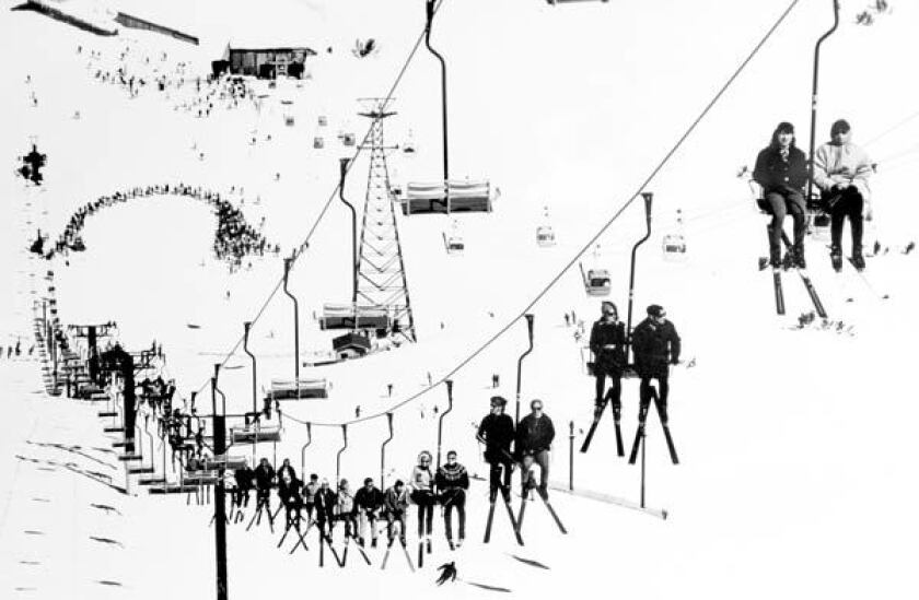 Skiers on a chairlift at Mammoth Mountain