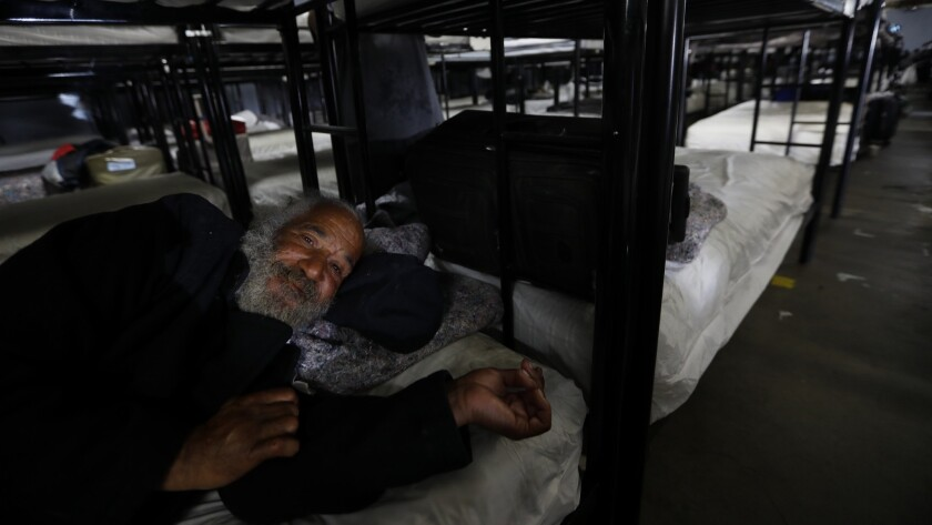 Bobby Washington, 60, rests on his bunk Volunteers of America shelter in South Los Angeles, CA April 18, 2018. He says he has been homeless for several years.
