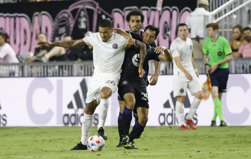 Inter Miami midfielder Gregore Silva (26) and CF Montreal midfielder Mathieu Choiniere (29) fight for the ball during the first half of an MLS soccer match Saturday, July 31, 2021, in Fort Lauderdale, Fla. (AP Photo/Rhona Wise)