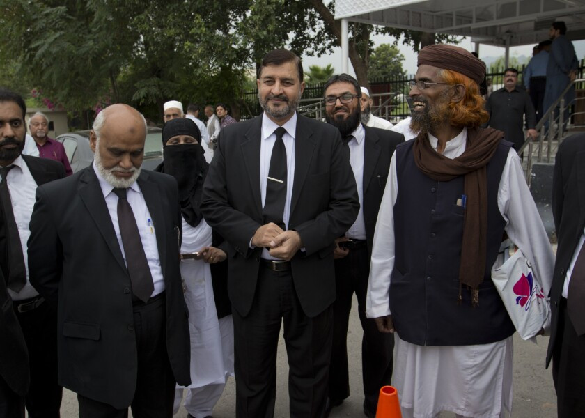 Pakistani lawyers who are contesting the case against Asia Bibi, a Pakistani Christian woman convicted of blasphemy, leave the Supreme court building in Islamabad, Pakistan, Monday, Oct. 8, 2018.