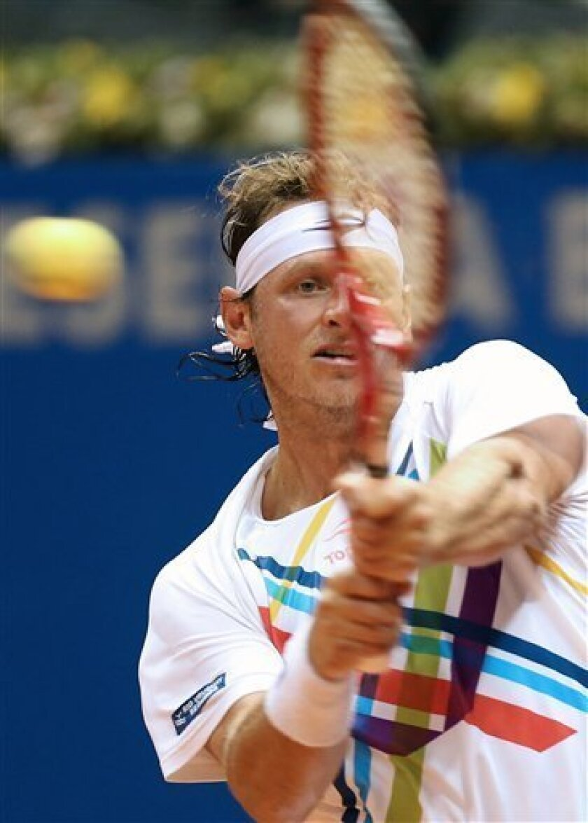 Argentina's David Nalbandian returns the ball to Italy's Simone Bolelli during a Brazil Open ATP tournament semifinal tennis match in Sao Paulo, Brazil, Saturday, Feb. 16, 2013. (AP Photo/Andre Penner)