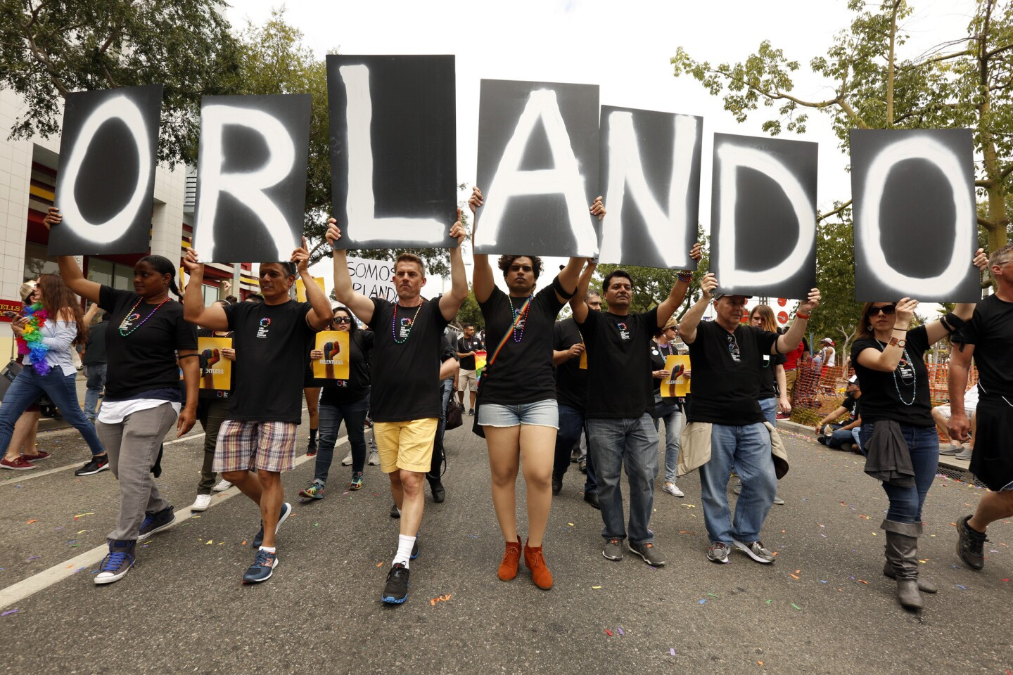 Marchers hold letters that spell out Orlando in support of the victims in the shooting during the annual Gay Pride parade in West Hollywood.