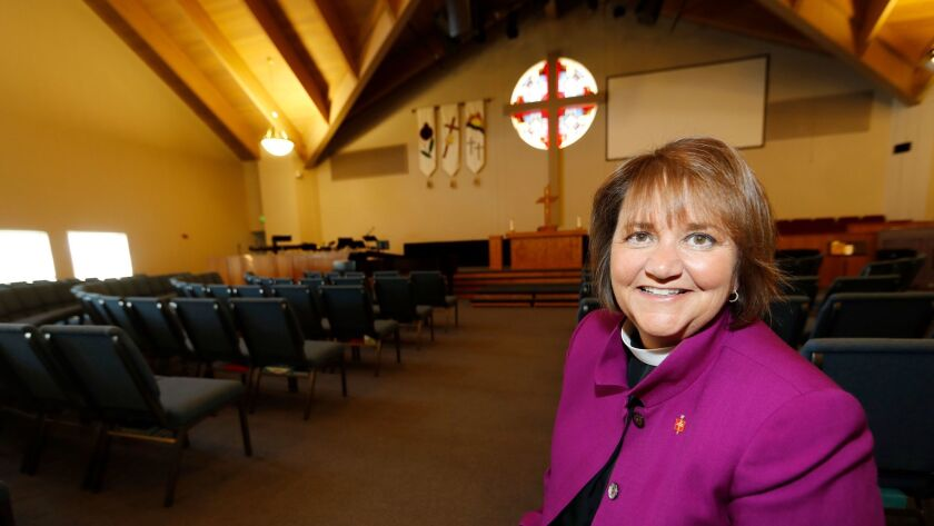 Bishop Karen Oliveto in the sanctuary of her church in Highlands Ranch, Colo. The United Methodist Church is reviewing whether she can remain in the post.