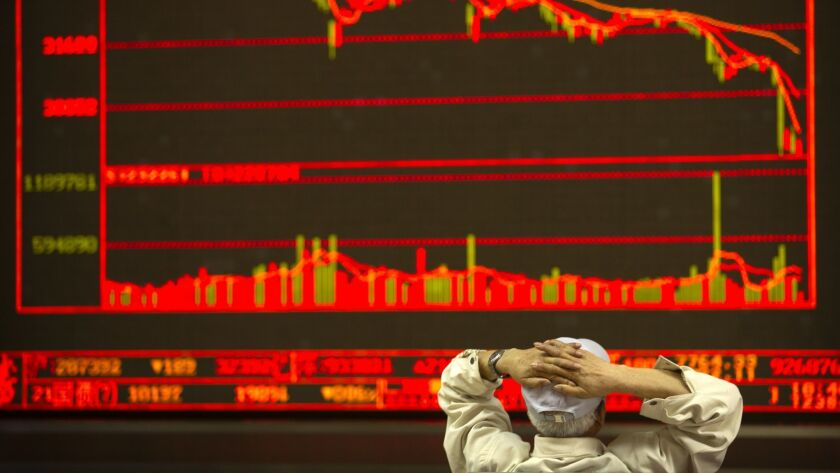 A Chinese investor monitors stock prices at a brokerage house in Beijing, Friday, June 22, 2018. Asi