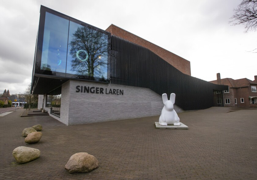 """FILE- In this Monday March 30, 2020, file photo, the exterior of the Singer Museum is seen in Laren, Netherlands. A 59-year-old man, described as an """"incorrigible and calculating criminal"""" was convicted Friday of stealing a painting by Vincent van Gogh and another by Frans Hals from two Dutch museums last year and sentenced to the maximum eight years in prison. The man, whose identity was not released in line with Dutch privacy rules, was found guilty of snatching the Van Gogh painting """"The Parsonage Garden at Nuenen in Spring 1884"""" from the Singer Laren museum east of Amsterdam and """"Two Laughing Boys"""" by Frans Hals that was stolen from the Museum Hofje van Mevrouw van Aerden in Leerdam, 60 kilometers (about 35 miles) south of Amsterdam, , the Central Netherlands Court said in a statement. (AP Photo/Peter Dejong, File)"""
