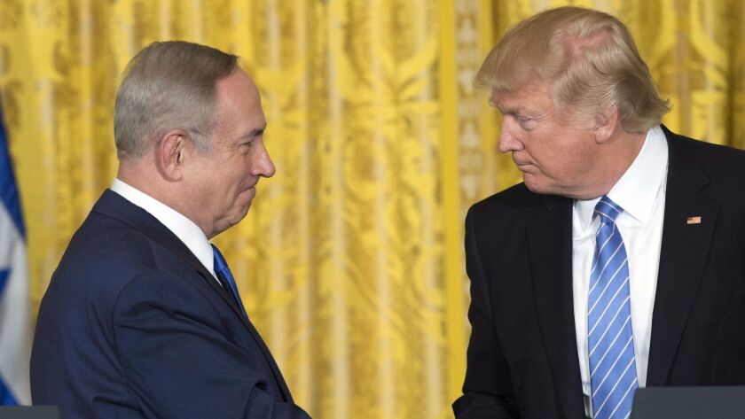 (FILES) This file photo taken on February 15, 2017 shows US President Donald Trump (R) and Israeli