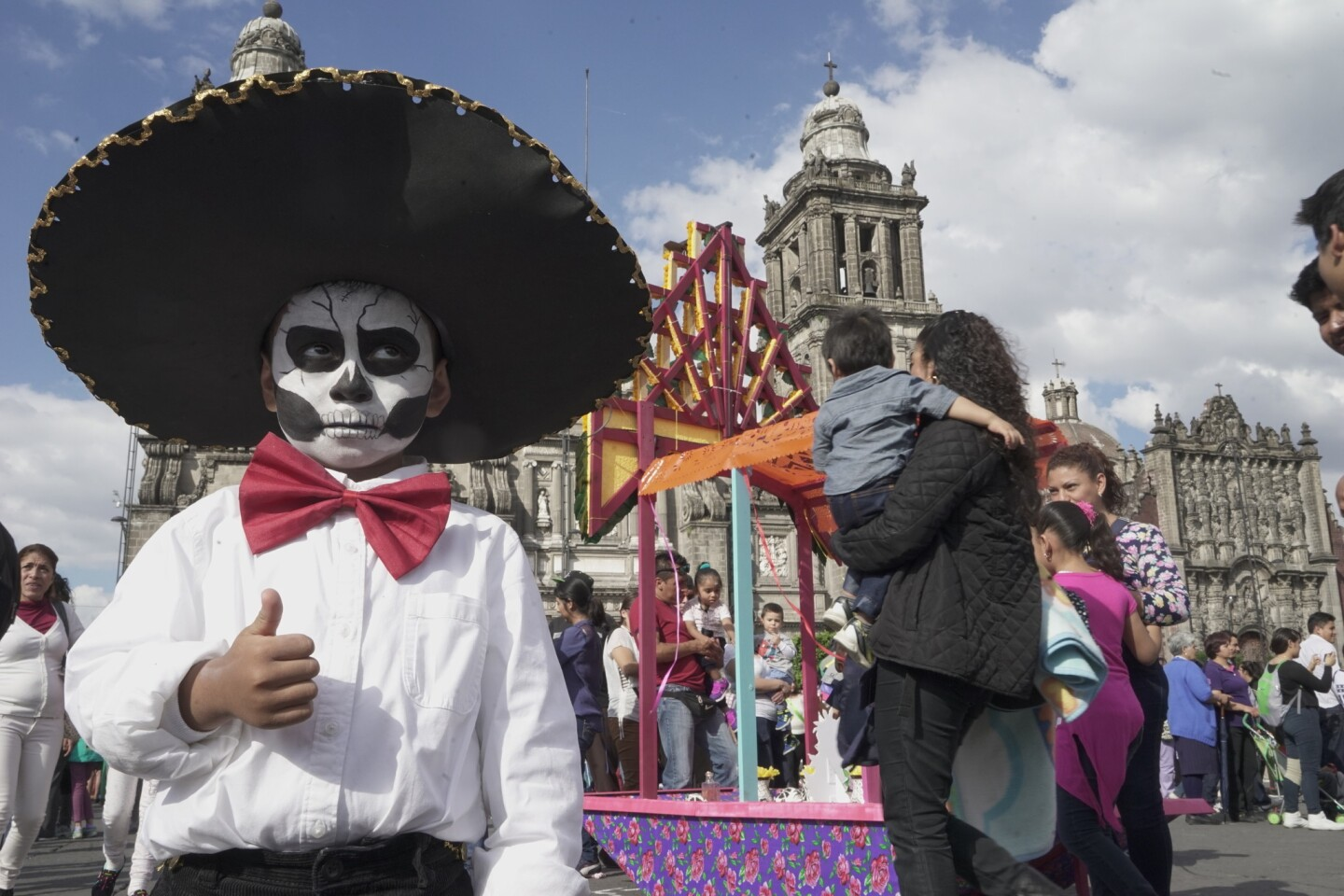 Dilan Bautista, 4, joins the festivities during Mexico City's first Day of the Dead parade. More than 250,000 people attended.