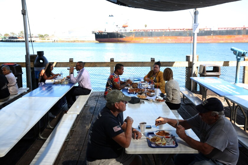 Dining beside the water at the San Pedro Fish Market in San Pedro.