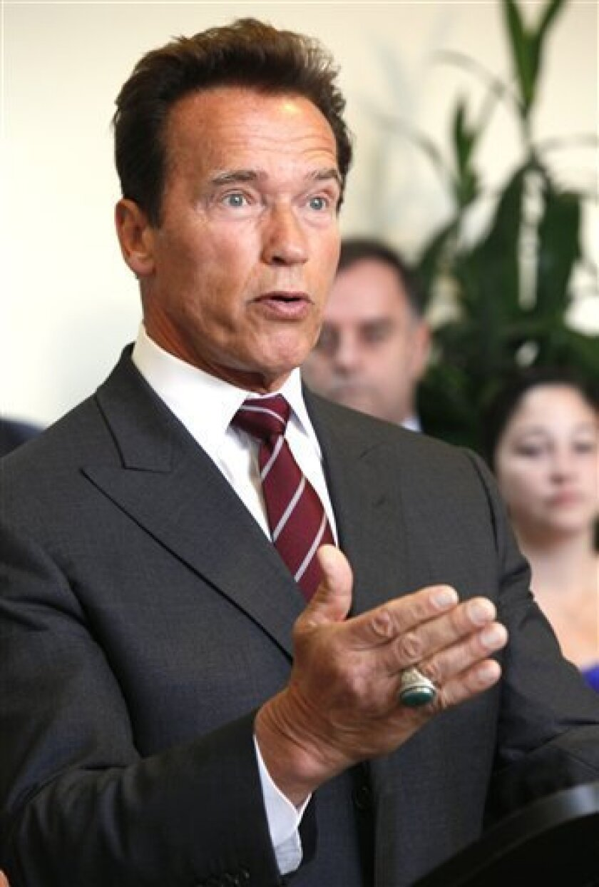FILE - In this June 9, 2010 file photo, California Gov Arnold Schwarzenegger speaks at news conference to applaud the passage of Proposition 14 in Los Angeles. Schwarzenegger's order to pay 200,000 state workers just the minimum wage sent a signal to California lawmakers: In the impasse over closing California's $19 billion budget deficit, the governor is ready to play hardball. (AP Photo/Nick Ut)