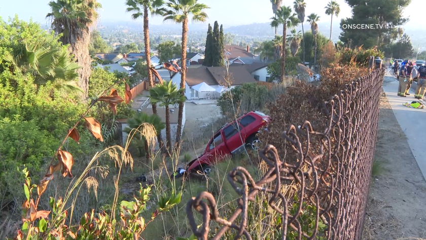 An SUV plunged down an embankment in the La Presa area of Spring Valley on Wednesday, killing a passenger.
