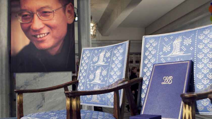 An empty chair in Oslo symbolizing Nobel Peace Prize winner Liu Xiaobo's absence from the ceremony in which he was to be awarded a diploma and medal. The diploma rests on the chair.