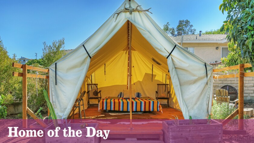This cottage in Eagle Rock charms with a creative studio and a tent for luxurious camping.