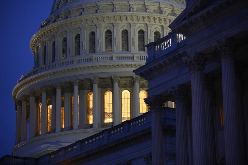 Light illuminates the U.S. Capitol dome  in Washington