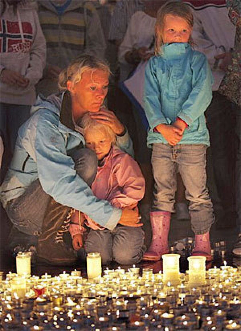 Friends and loved ones gather at the Oslo cathedral to mourn victims killed in a bombing and mass shooting in Norway in July 2011.