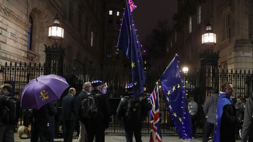 Pro and Anti Leaving the European Union campaigners stand outside the entrance to Downing Street, in
