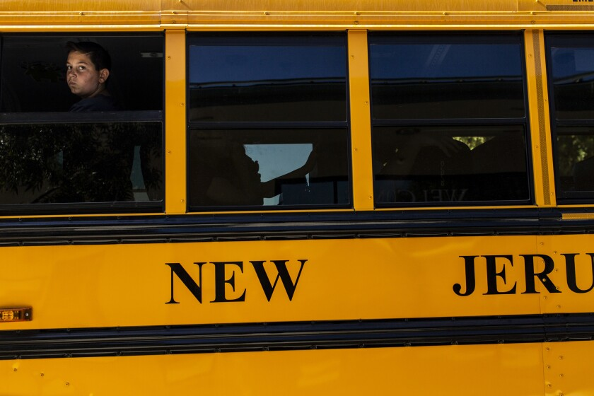 TRACY, CALIF. - OCTOBER 24: Students board a yellow New Jerusalem school bus on Wednesday, Oct. 24,