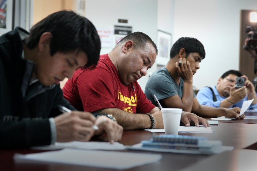 """Undocumented Immigrants take a practice test as they attend a new driver's license test preparation class entitled """"Road to Success"""" at The Coalition for Humane Immigrant Rights of Los Angeles."""