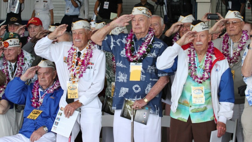 Lou Conter (center in blue shirt) and other survivors of the attack on Pearl Harbor salute during a wreath-laying ceremony Dec. 7, 2015. Conter is one of only five still-living veterans who were aboard the USS Arizona.