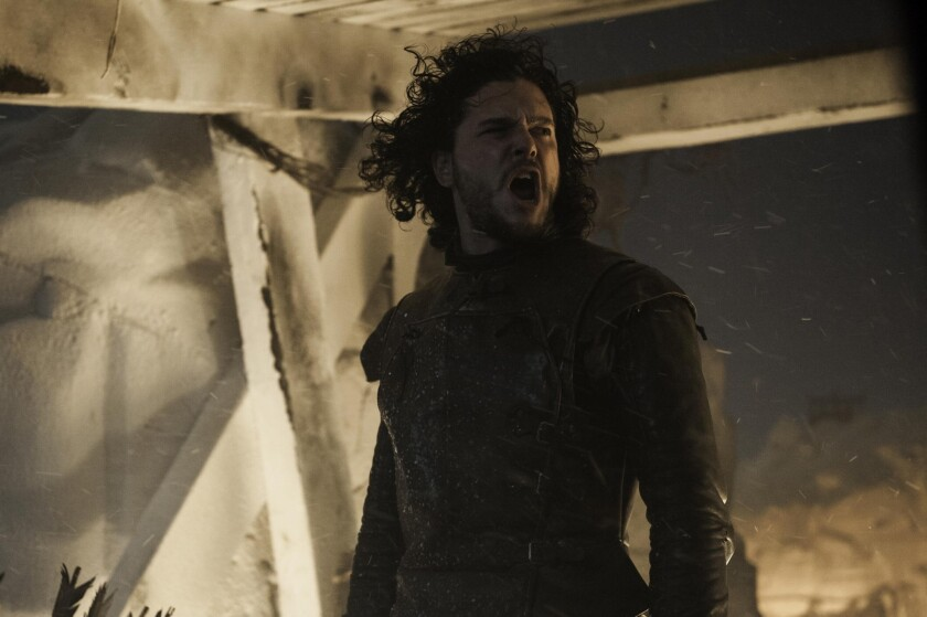 "Kit Harington plays Jon Snow, standing atop the Wall in ""Game of Thrones."""