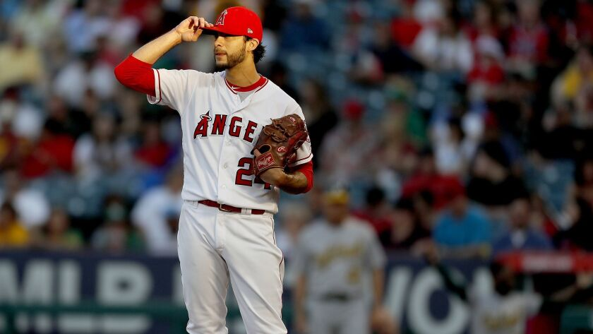ANAHEIM, CALIF. - JUNE 28, 2019. Angels starter Noe Ramirez reacts after giving up a two-run homer a