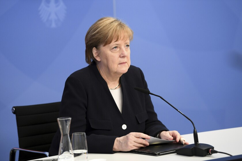 German Chancellor Angela Merkel arrives to attend a virtual event with Dutch Prime Minister Mark Rutte at the Chancellery in Berlin, Germany, Wednesday, May 5, 2021 marking the Liberation Day, the end of the occupation of the Netherlands by Nazi Germany during World War II. (Annegret Hilse/Pool Photo via AP)