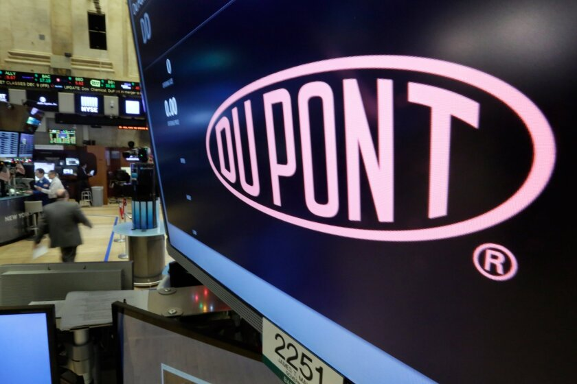 FILE - In this Dec. 9, 2015, file photo, the company name of Dupont appears above its trading post on the floor of the New York Stock Exchange. Dupont reports quarterly financial results, Tuesday, Jan. 26, 2016. (AP Photo/Richard Drew, File)