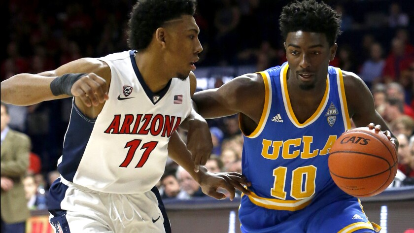 UCLA guard Isaac Hamilton (10) drives against Arizona guard Alonzo Trier during the second half of their game Friday night.