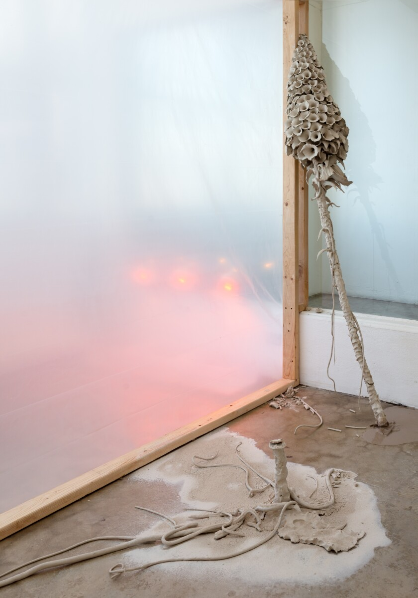 """A two-piece installation, rendered in a gray stoneware clay, speaks to the show's title, """"Cut."""""""