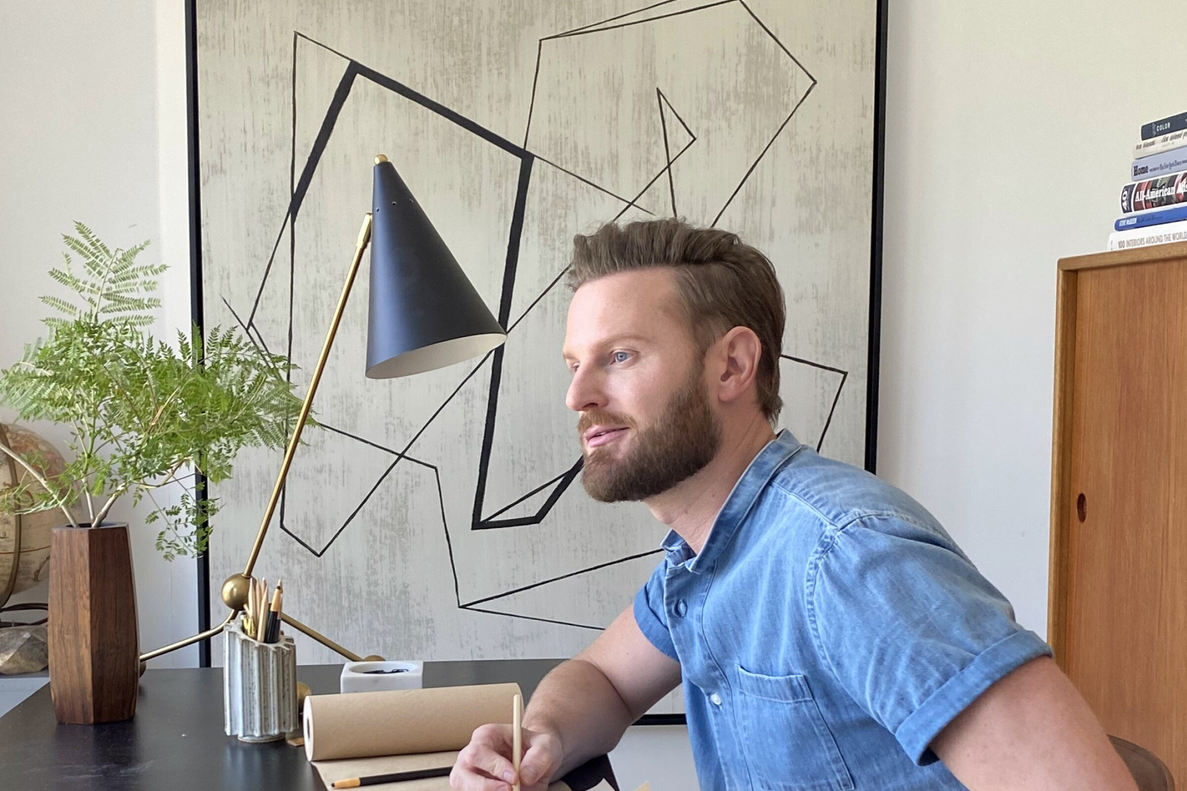 """Queer Eye"" design expert Bobby Berk, pictured in his home office."