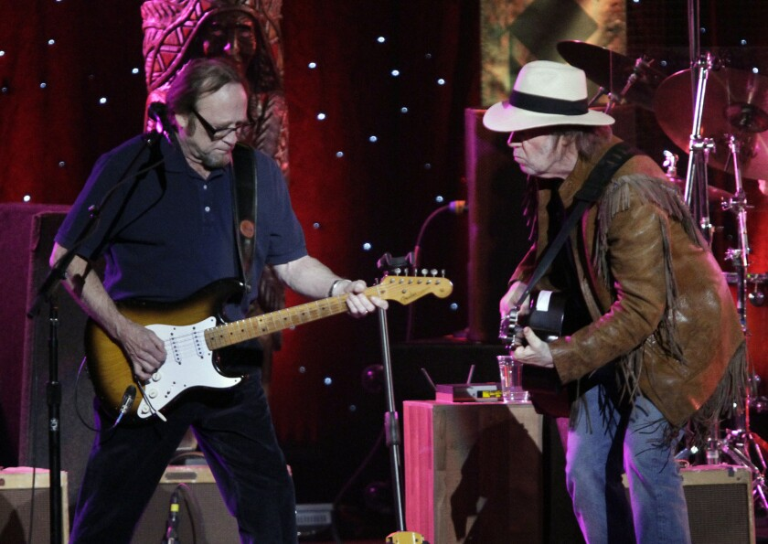 Neil Young, at right with Stephen Stills during Buffalo Springfield's 2011 reunion show in Los Angeles, will headline the third Light Up the Blues benefit for Autism Speaks, organized by Stills and his wife, Kristen. The show is Saturday, April 25, at the Pantages Theatre in Hollywood.