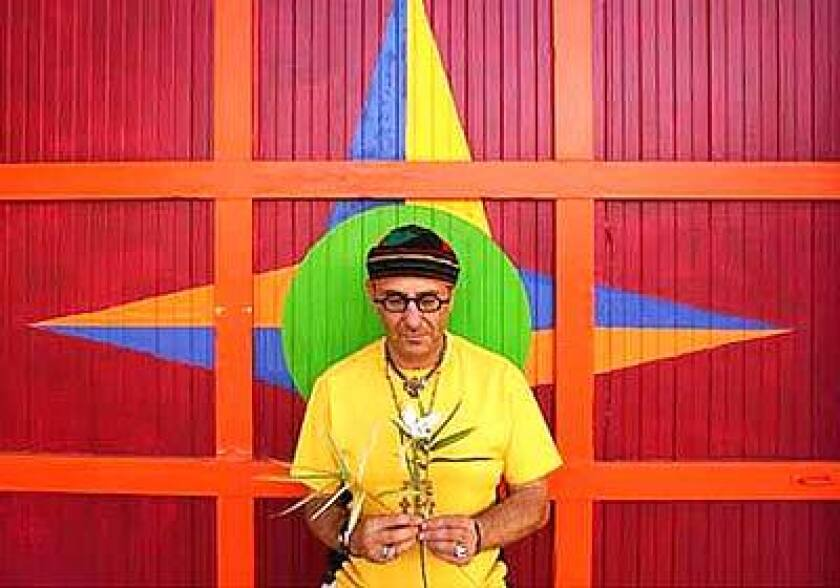 Harry Segil has a still moment in front of the garage painted in the same shades as the exterior of his former Spanish Revival house.
