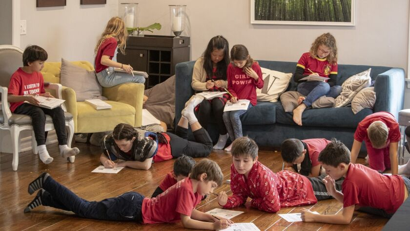 """Kids from Encino Charter Elementary School -- dressed in red to support their teachers -- attend a community-organized """"strike school"""" in Encino, Calif. Parents are taking turns hosting kids in their homes and creating a curriculum."""