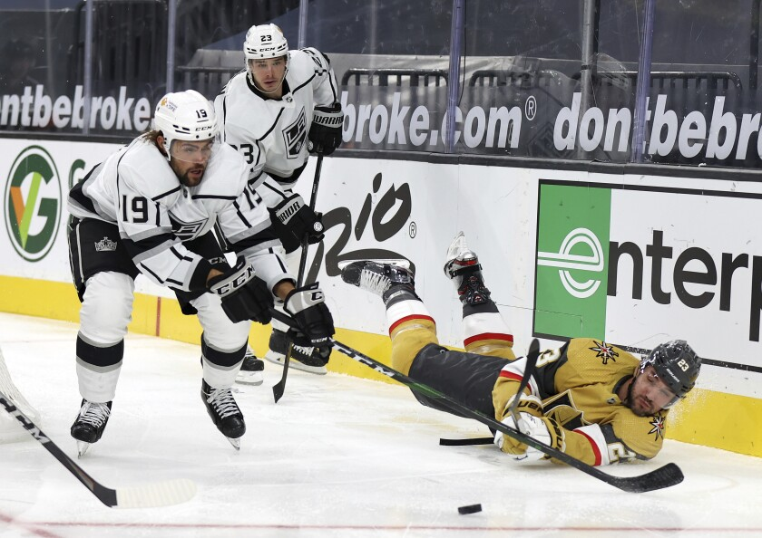 Kings center Alex Iafallo, left, and Vegas defenseman Alec Martinez battle for control of the puck Feb. 7 in Las Vegas.
