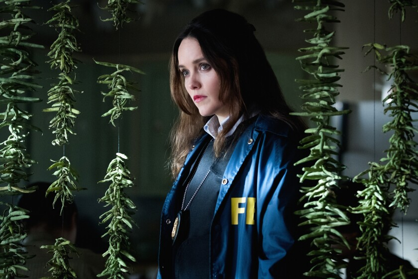 "Rebecca Breeds wears an FBI jacket in ""Clarice."""