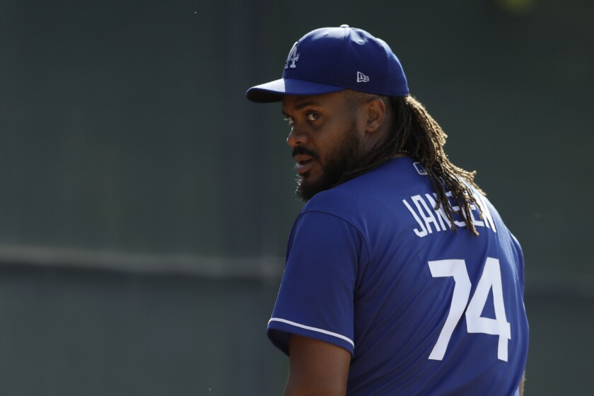 Dodgers relief pitcher Kenley Jansen looks on during spring training.