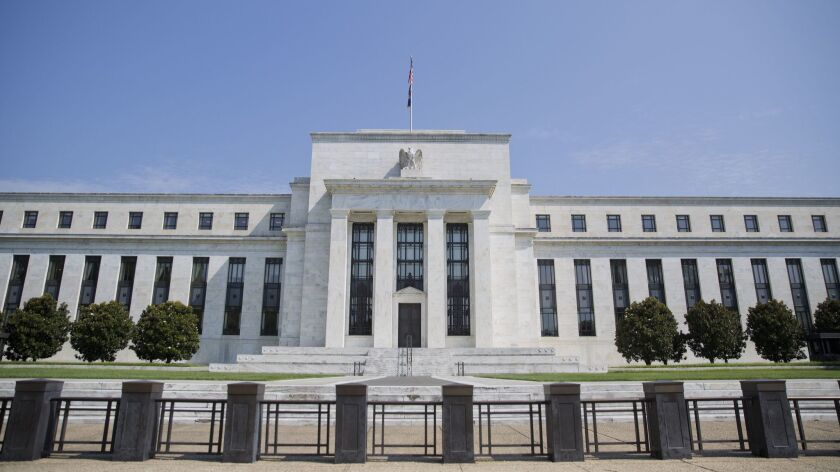 FILE - This Wednesday, Aug. 2, 2017, file photo shows the Federal Reserve Building on Constitution A