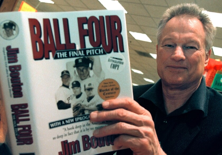 """Former major league pitcher Jim Bouton signs copies of his book, """"Ball Four: The Final Pitch,"""" on No"""