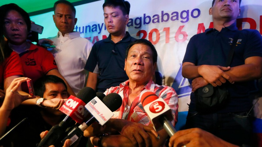 Philippine president-elect Rodrigo Duterte is interviewed by the media shortly after voting in a polling precinct during the May 9 election.