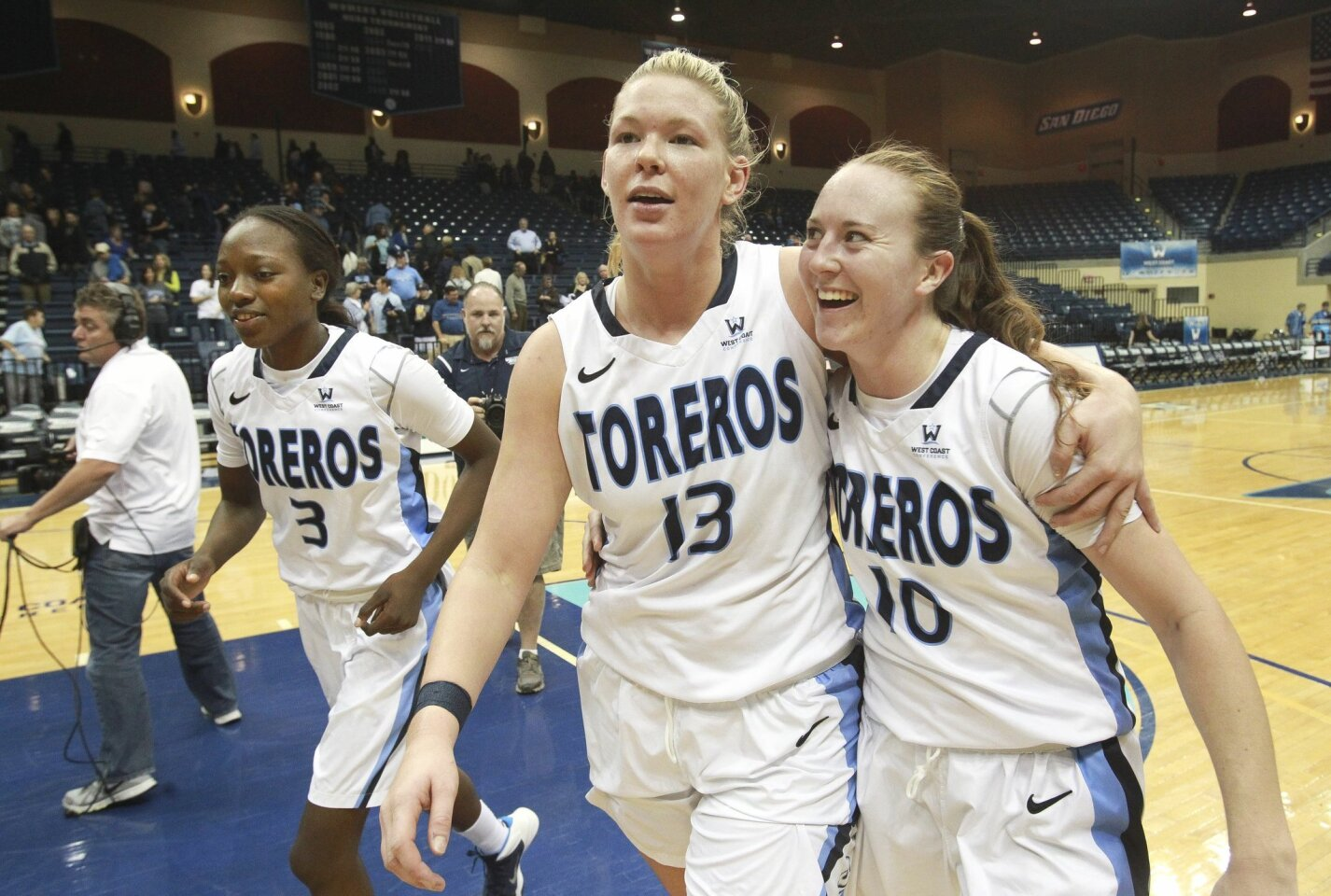 USD players, from left, Sophia Ederaine, Felicia Wijenberg, and Amy Kame leave the court after USD defeated St. Mary's 80-70 at the Jenny Craig Pavilion on January 2, 2014.