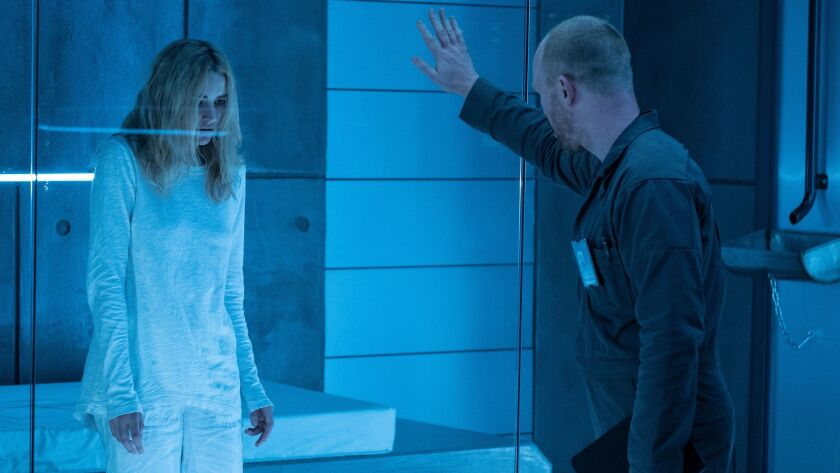"""Brianne Howey, left, in a scene from the television series """"The Passage."""""""