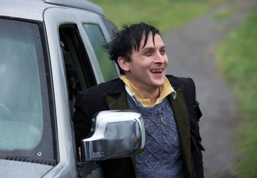 "In this image released by Fox, Robin Lord Taylor is shown in a scene from ""Gotham,"" premiering on Monday, Sept. 22 at 8:00 ET/PT. (AP Photo/Fox, Jessica Miglio)"