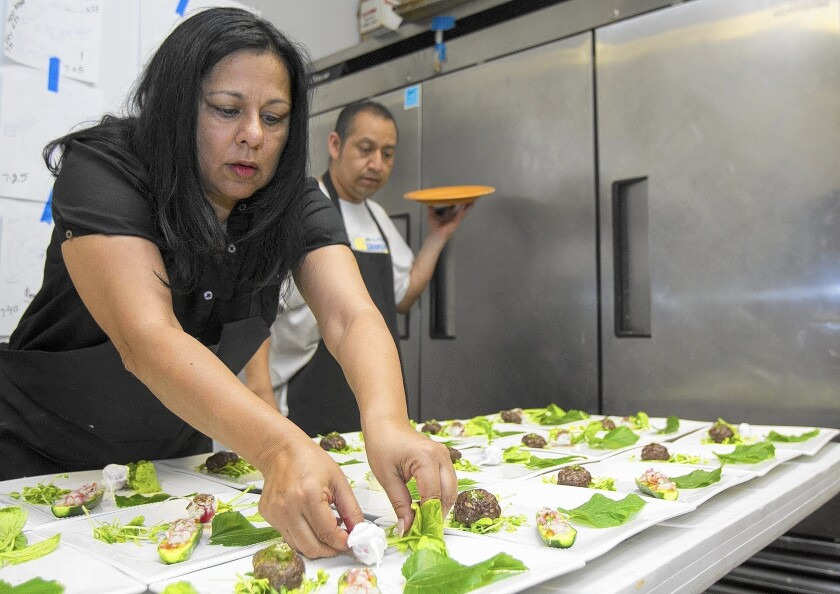 Chef Geeta Bansal prepares an appetizer at her restaurant, the Clay Oven.