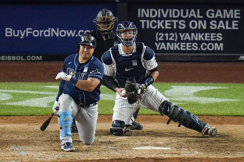 Tampa Bay Rays' Ji-Man Choi reacts after striking out during the ninth inning of the team's baseball game against the New York Yankees on Wednesday, June 2, 2021, in New York. The Yankees won 4-3. (AP Photo/Frank Franklin II)